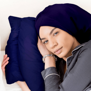 silkup model laying on silk pillow in hair wrap