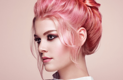 woman-with-pink-hair-up-on-pink-background